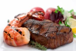 Mmm... a giant juicy prawn with a giant hunk of juicy steak.  Shallow dof